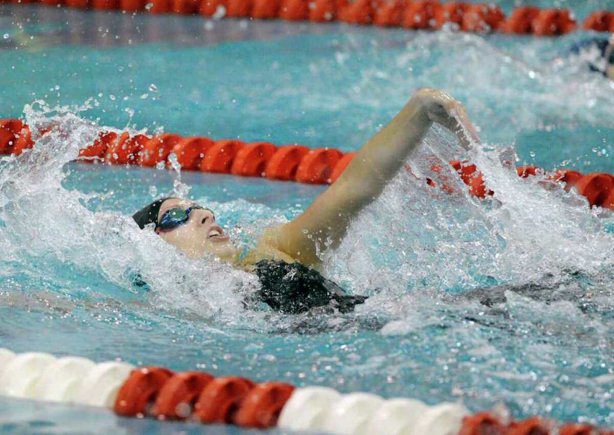 Adelyn Graf of New Canaan High School competes in the 100 meter backstroke event during the FCIAC Swimming Championships at Greenwich High School, Saturday, Nov. 6, 2010. Graf's team, New Canaan High School, won the championship.