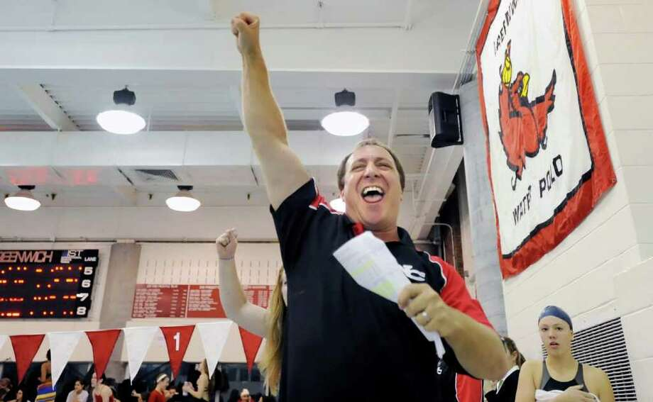 New Canaan High School swimming coach Dave Fine pumps his fist into the air during the FCIAC Swimming Championships at Greenwich High School, Saturday, Nov. 6, 2010.  Fine's team, the New Canaan High School Rams, came out on top and won the FCIAC Championship. Photo: Bob Luckey / Greenwich Time