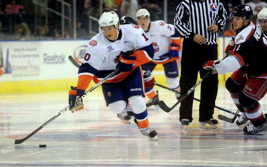 Rhett Rakhshani of the Soundtigers takes the puck toward the net during Saturday's game against the Hartford Wolf Pack at the Arena at Harbor Yard on November 6, 2010. Photo: Lindsay Niegelberg / Connecticut Post