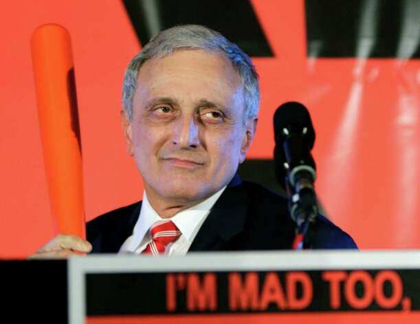 GOP gubernatorial candidate Carl Paladino holds a bat as he concedes the election Tuesday in Buffalo. Paladino, a tea party supporter,  won the Republican nomination for governor in a primary. The party won no statewide races. (David Duprey/Associated Press) Photo: David Duprey / AP