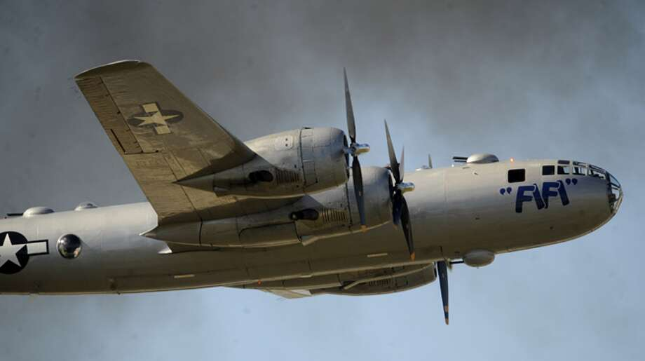 "The Commemorative Air Force B-29 ""Fifi"" flies over the flight line during AirFest 2010."