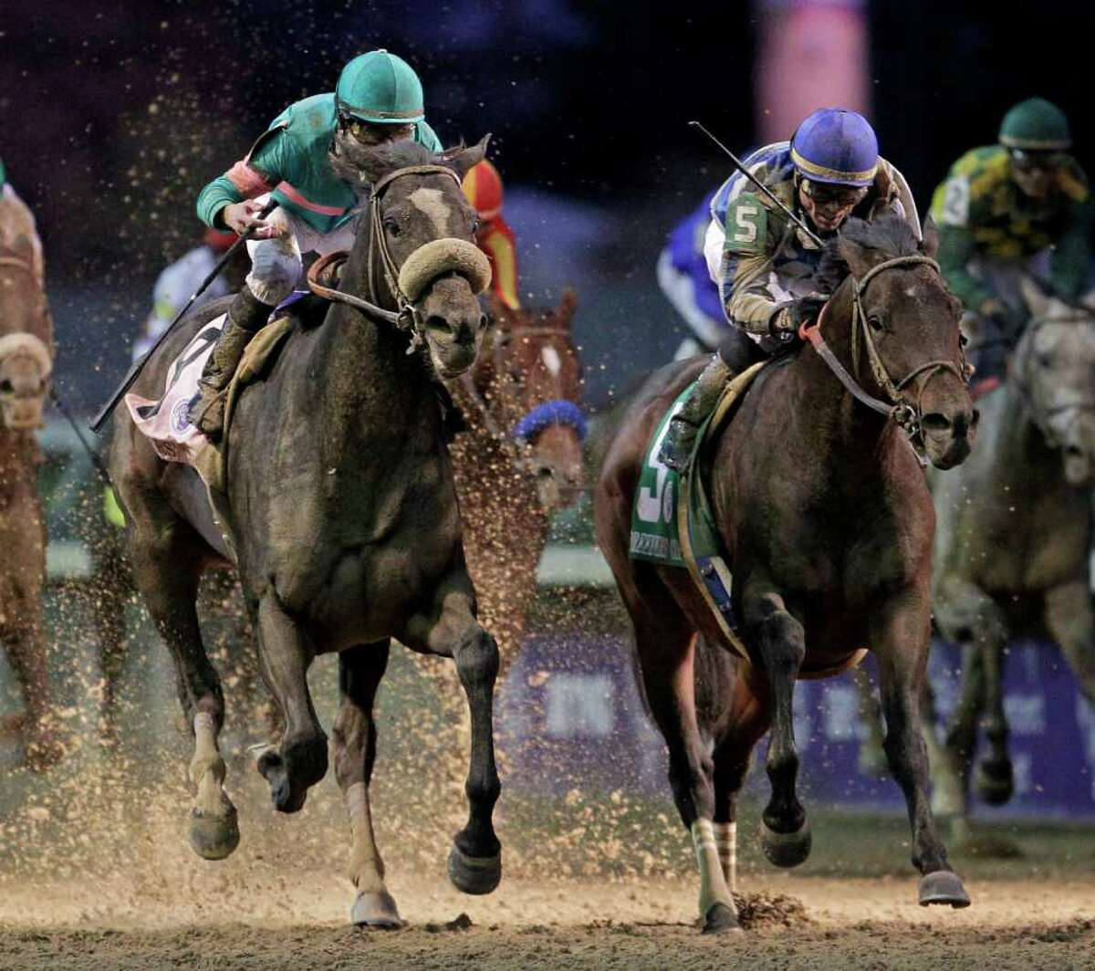 Garrett Gomez, right, rides Blame to victory during the Classic race at the Breeder's Cup horse races at Churchill Downs Saturday, Nov. 6, 2010, in Louisville, Ky. Mike Smith riding Zenyatta finished second. (AP Photo/Darron Cummings)