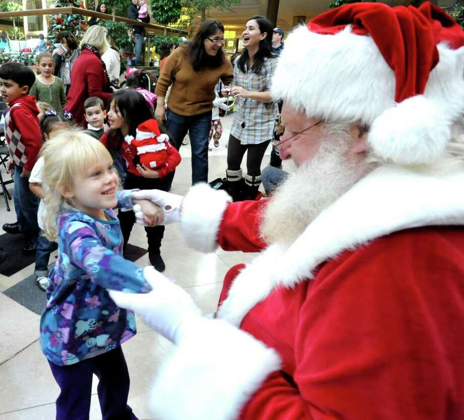 Sarah Madore, 5, of New Fairfield, dances with Santa during the Somebody Wake Up Santa show at the Danbury Fair mall, Saturday, Nov. 6, 2010. Photo: Michael Duffy / The News-Times