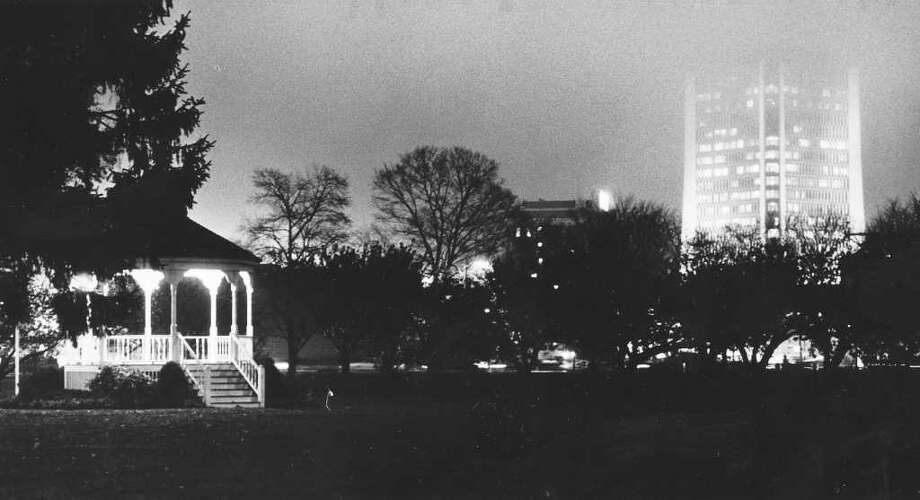 November 13, 1985 : Clouds close in over Stamford obsuring the top of the Landmark Building as seen from Mill River Park. Photo: ST