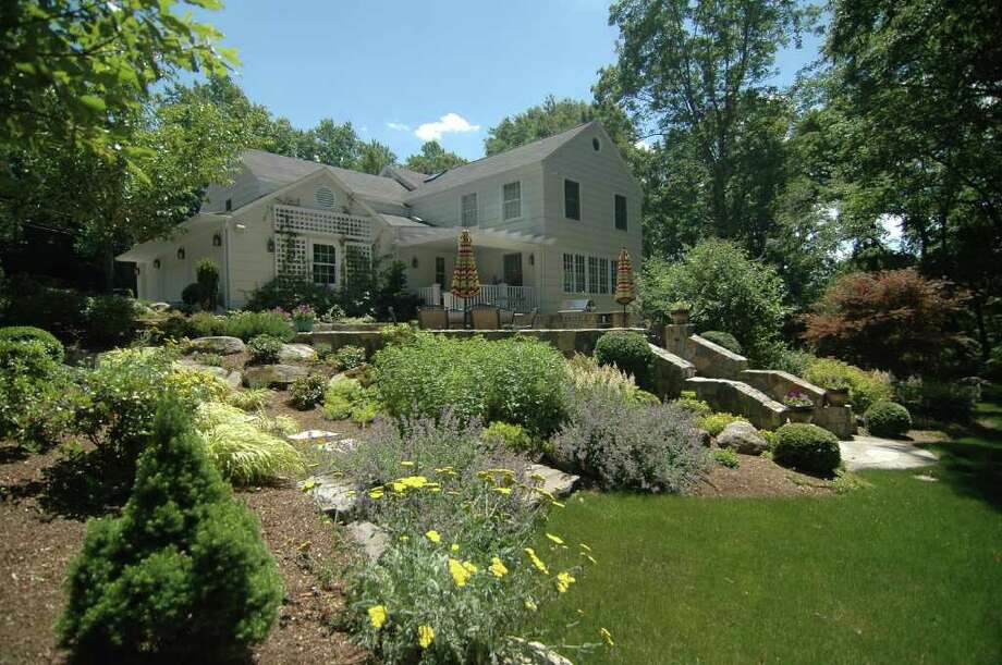 The house at 21 Catamount Road in Westport sits on 2 acres and is listed for $1,699,000. Photo: Contributed Photo / Westport News contributed