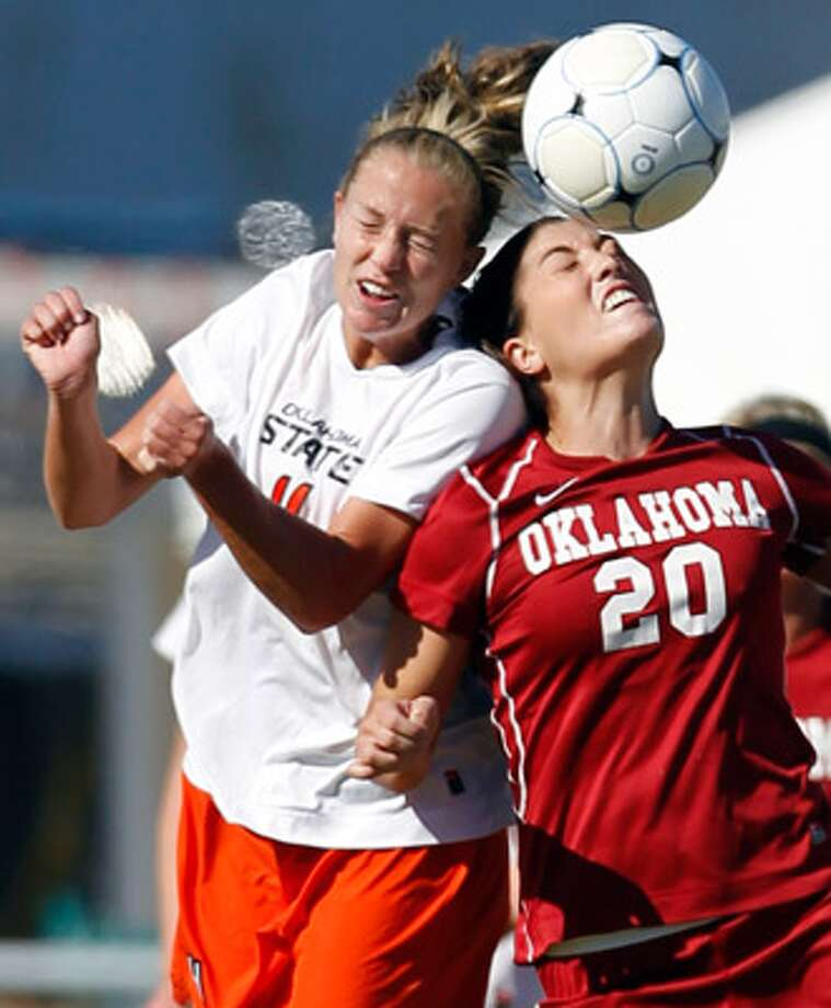 OSU's Whitney Wernimont (left) and OU's Annalisa Hall go up for a header Sunday at Blossom Soccer Stadium.