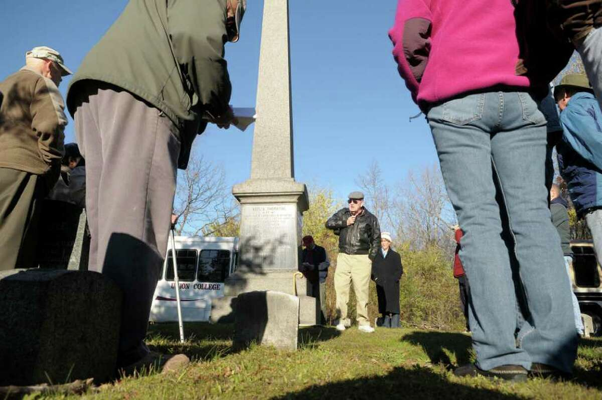 Siena College History Professor Tom Kelly, background center, leads a tour during the Vale & Valor event at Vale Cemetery in Schenectady, on Sunday. The grave Kelly is stand near is that of James Seaman Casey, a recipient of the Congressional Medal of Honor when he fought in the Indian campaigns. The Vale & Valor was a tour of the cemetery noting along the way certain graves of soldiers who fought in the great military conflicts from 1775-1945. The cemetery runs different tour programs from April to November each year. (Paul Buckowski / Times Union)
