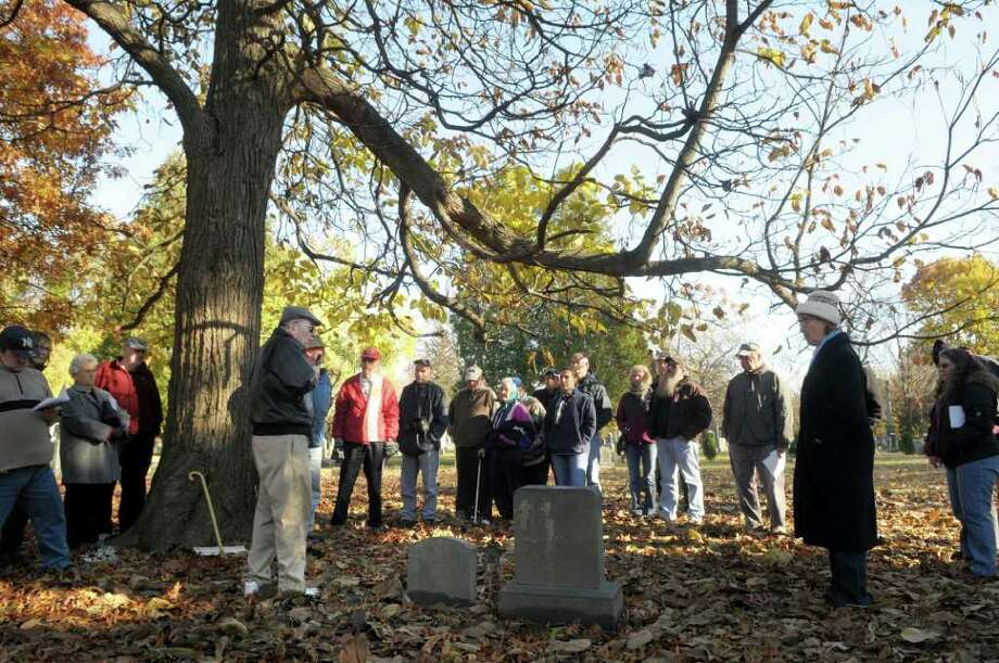 "Siena College History Professor Tom Kelly, foreground left, leads a tour  during the Vale & Valor event at Vale Cemetery in Schenectady, on Sunday.  The grave Kelly is standing near is that of Jared Jackson, an African American who served with the ""U.S. Colored Troops"" Co. N. 20th Regiment during the Civil War.   The Vale & Valor was a tour of the cemetery noting along the way certain graves of soldiers who fought in the great military conflicts from 1775-1945.   The cemetery runs different tour programs from April to November each year.  (Paul Buckowski / Times Union) Photo: Paul Buckowski / 00010920A"