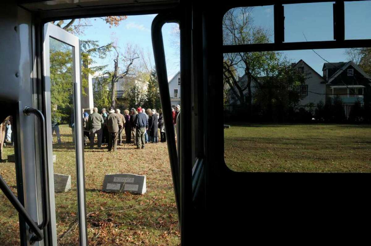 Visitors depart the bus at the first stop during the Vale & Valor event at Vale Cemetery in Schenectady, on Sunday. The Vale & Valor was a tour of the cemetery noting along the way certain graves of soldiers who fought in the great military conflicts from 1775-1945. The cemetery runs different tour programs from April to November each year. (Paul Buckowski / Times Union)