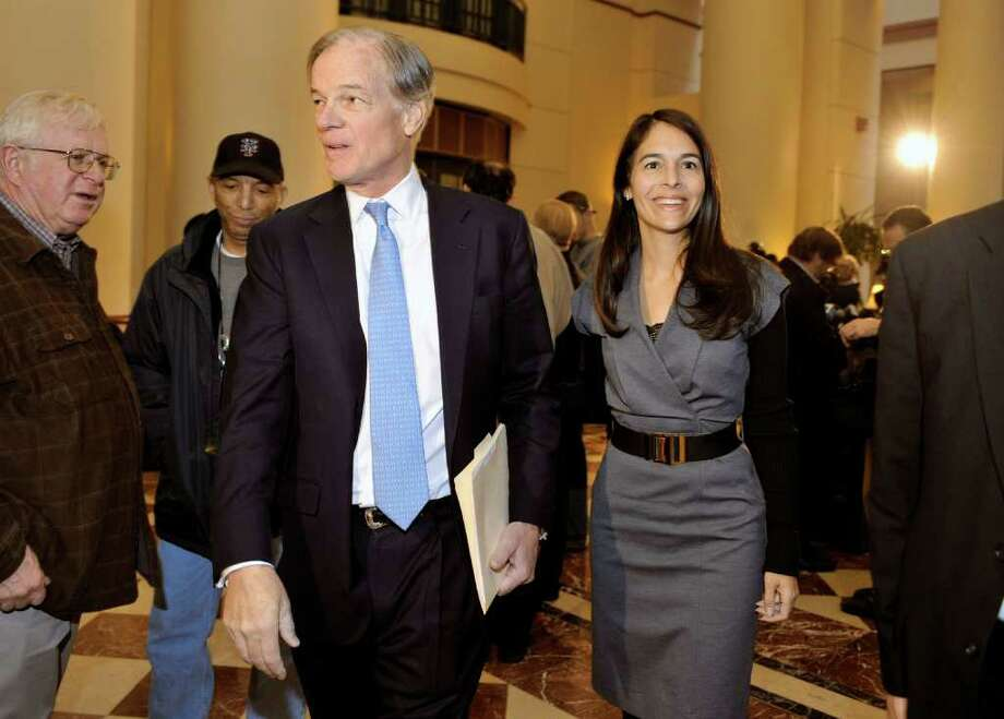 Tom Foley, the Republican candidate for governor of Connecticut, leaves a news conference with wife Leslie after conceding in the governor's race to Democrat Dan Malloy in Hartford, Conn., Mon, Nov. 8, 2010.  (AP Photo/Jessica Hill) Photo: Jessica Hill, AP / AP2010