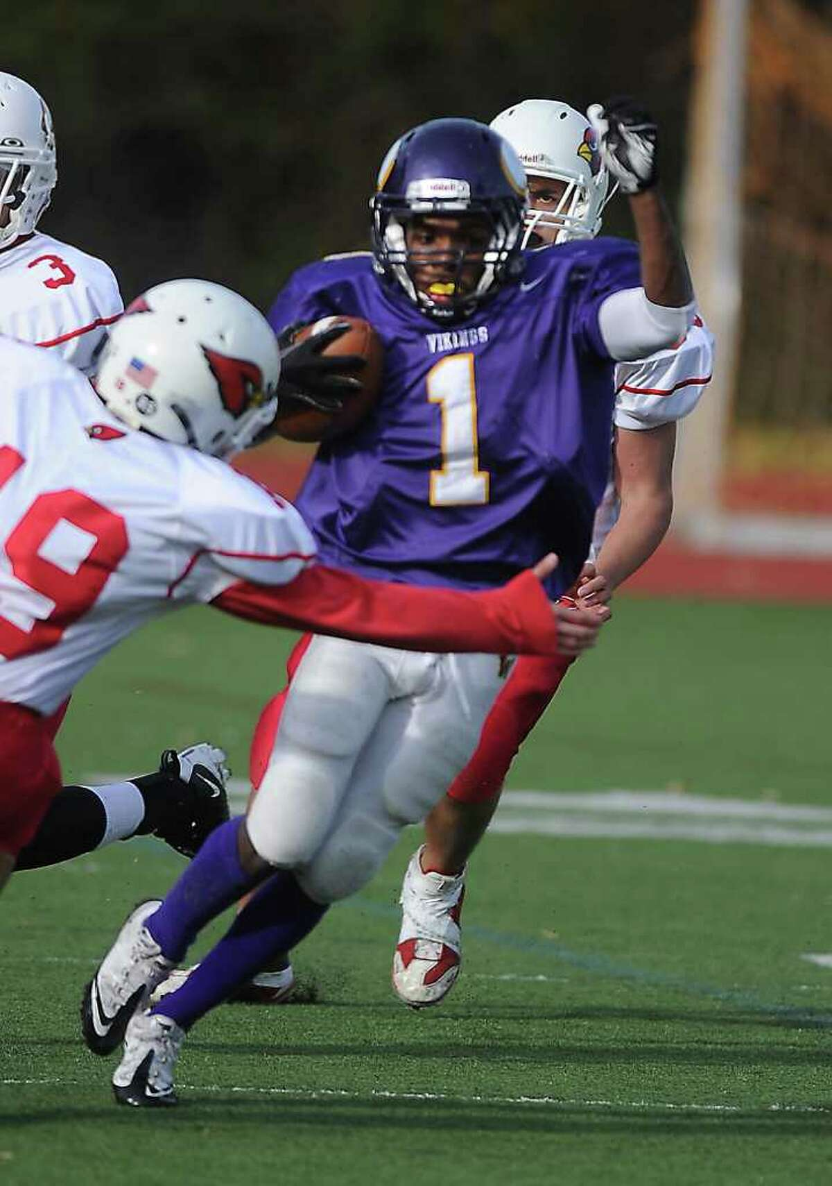 Westhill High School's Akai Jackson runs the ball against Greenwich High School in football action in Stamford, Conn. on Saturday October 30, 2010.