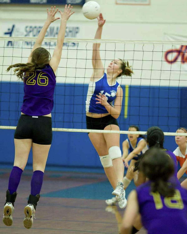 Danbury's Allison Murphy (15) slams a shot past Westhill's Naomi Huruitz during their first round Class LL state tournament match Monday at Danbury High.