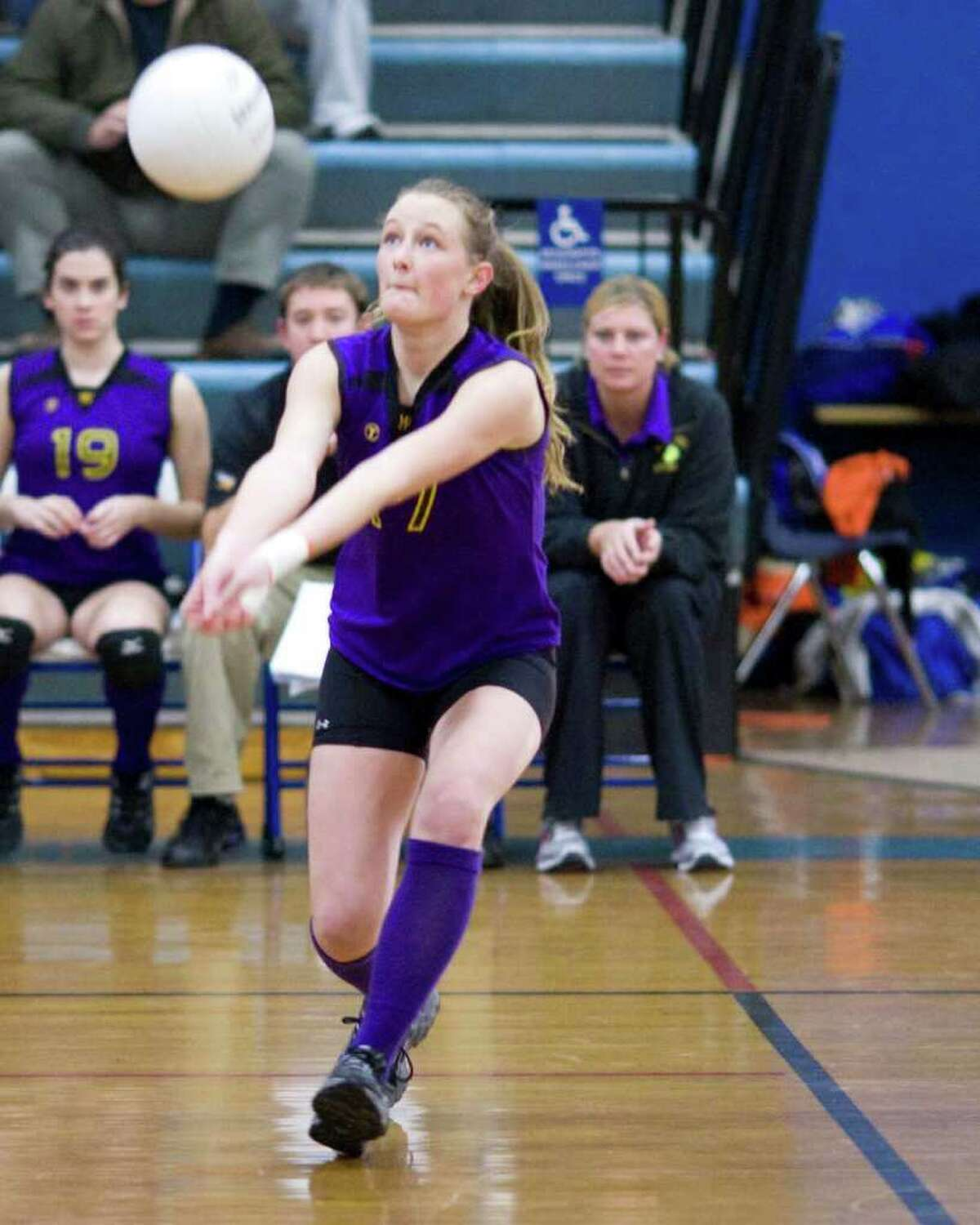 Westhill's Anne Hawthorn sets a shot during the Vikings' first round Class LL tournament match against Danbury Monday at Danbury High.