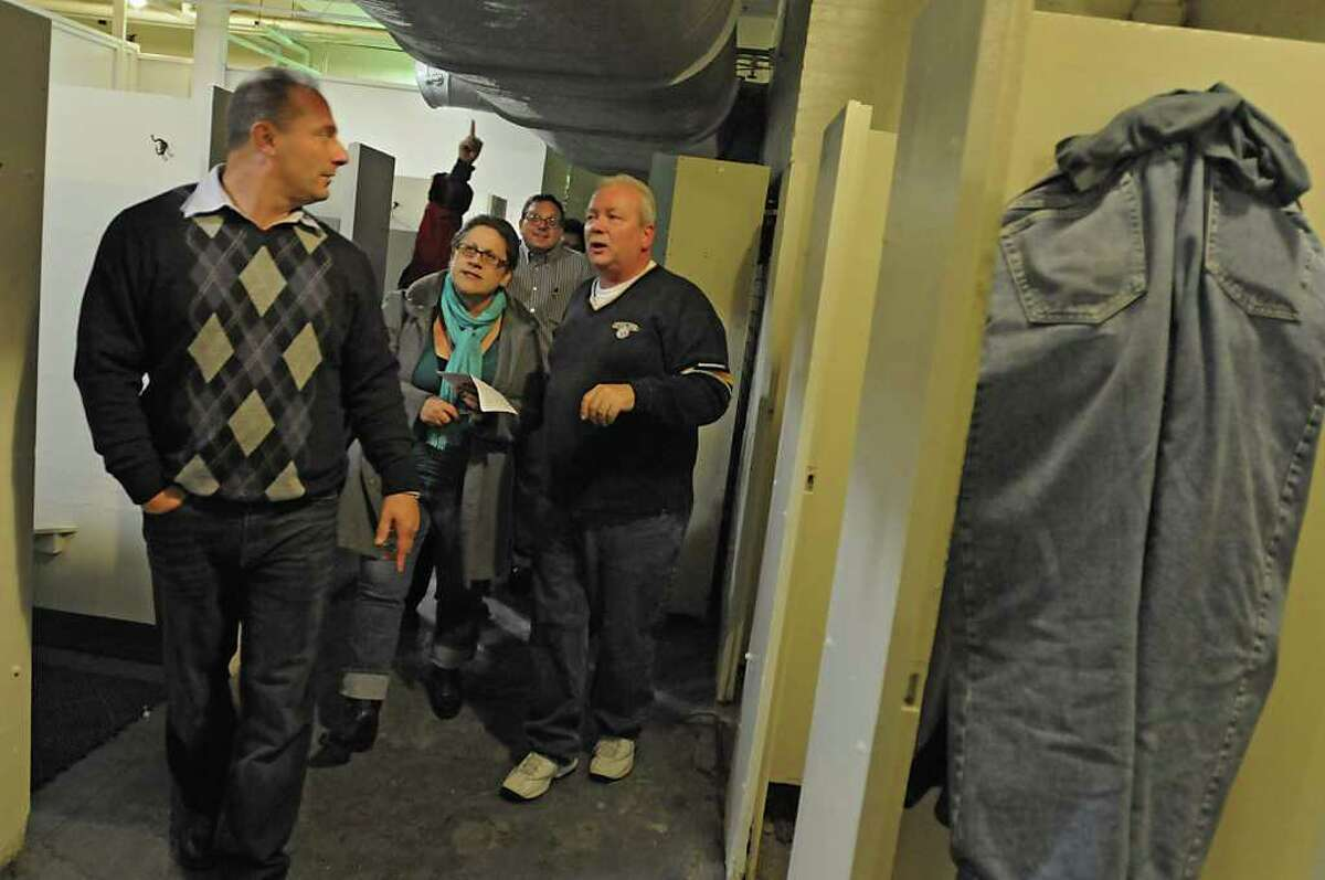 Members of the Albany Common Council and others walk through the mens locker room during a tour of the Public Bath No. 2 in Albany, NY on November 8, 2010. From left, John D'Antonio, Commissioner of Recreation, Susan Holland, Executive Director of Historic Albany Foundation, Dominick Calsolaro, Albany Common Council member, and John Lasch, Facility Supervisor for the City of Albany. The public bath is slated for closure under Mayor Jerry Jennings proposed 2011 budget. (Lori Van Buren / Times Union)