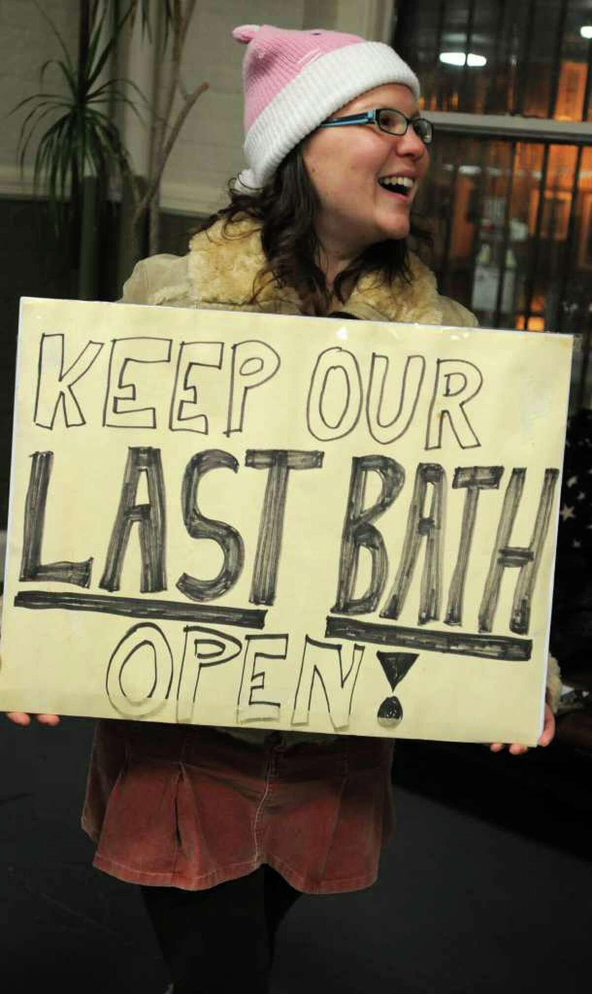 Elisabeth Mason ), originally from Albany, now lives in Maryland, holds a sigh as South End residents rally to save Public Bath No. 2 in Albany, NY on November 8, 2010. The public bath is slated for closure under Mayor Jerry Jennings proposed 2011 budget. (Lori Van Buren / Times Union)