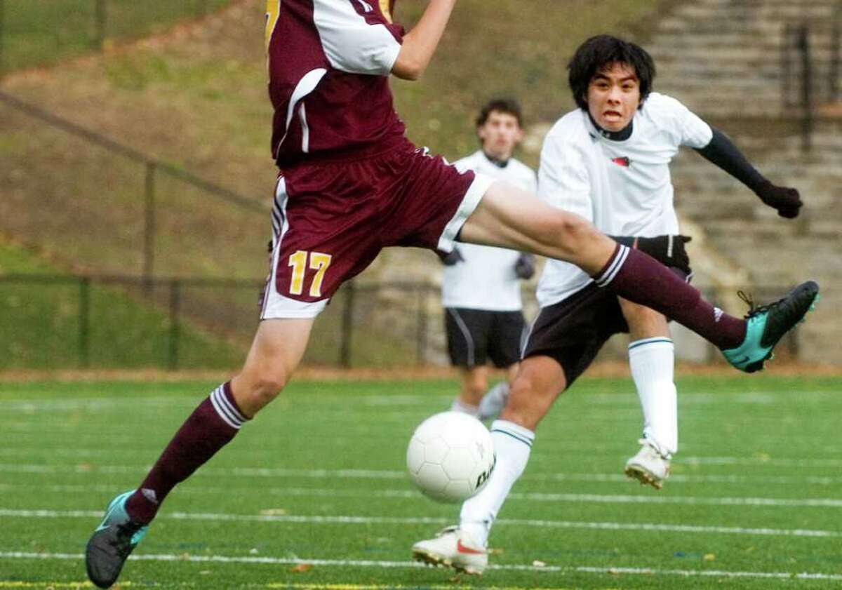 Greenwich High School's #5, Spencer Yanaka plays against South Windsor High School's Kevin Robbins, #17, in the first round of the Class LL boys soccer tournament hosted by Greenwich, on Monday, Nov. 8, 2010. Greenwich won the tournament.