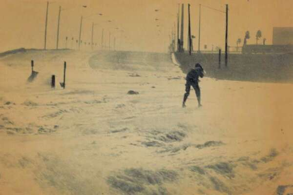 Gulf waters whipped into fury by winds of Hurricane Allen was across Ocean Drive near Corpus Christi State University as the hurricane neared the Texas Gulf Coast.