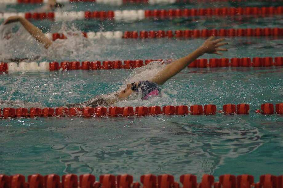Staples freshman Verity Abel wins the 100-yard backstroke with a time of 57.68 seconds at the FCIAC championship on Saturday at Greeenwich. The Lady Wreckers finished sixth out of 12 teams with 168 points. Photo: Contributed Photo / Ron Wimer