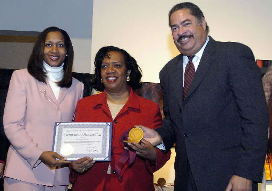 Annette De Lavallade, center, founder and editor of Classique Magazine, is shown in 2005 receiving an award from Michelle Chaney Donaldson, commissioner of the state Division of Human Rights, and James Harding, director of the Legislative Affairs Office of the Govenor, during ceremonies at the State Museum. ( Times Union archive )