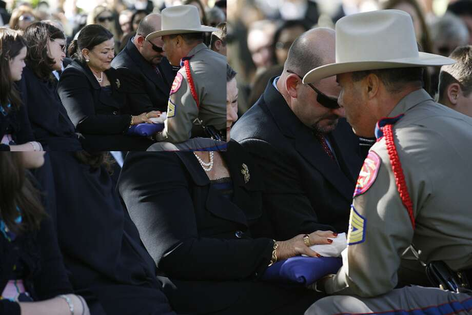 Birdie Kuempel, wife of Texas State Rep. Edmund Kuempel, receives the Texas flag from Department of Public Safety Sgt. James Lopez, during burial services.  To the left of Kuempel is her daughter, Margaret Brady and to right is her son, John Kuempel. JERRY LARA/glara@express-news.net