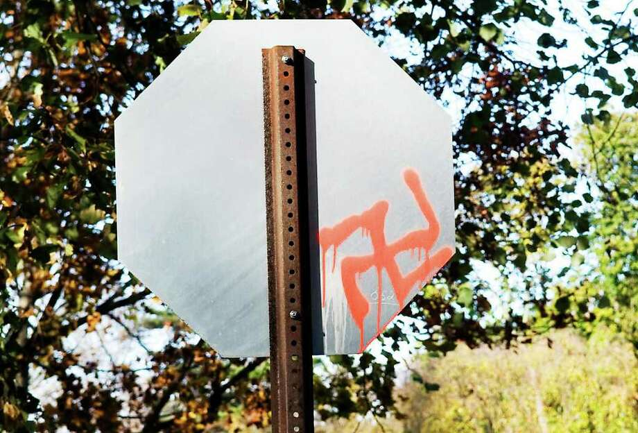 A swastika symbol and a racial slur were spray painted on a sign and on the street at the corner of Fairview Ave. and Van Rensselaer Ave. in the Shippan neighborhood in Stamford, Conn. on Tuesday November 9, 2010. Photo: Kathleen O'Rourke / Stamford Advocate
