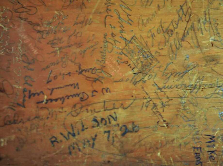 Detail of graffiti on a writing chair belonging to Dewitt Clinton, part of an upcoming public display of historic artifacts at the state Capitol Tuesday afternoon November 9, 2010.  (John Carl D'Annibale / Times Union) Photo: John Carl D'Annibale / 10010997A