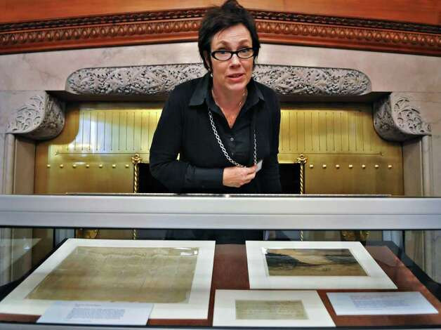 Maria S. Holden, chief of archival services and artifacts for the state, with an exhibit of Benedict Arnold papers from 1780 on loan from the State Library and Archives collections for an upcoming public display at the state Capitol Tuesday afternoon November 9, 2010.  (John Carl D'Annibale / Times Union) Photo: John Carl D'Annibale / 10010997A