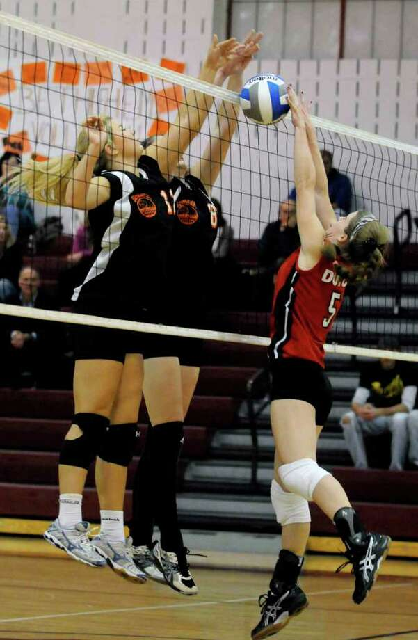 High school fall sports -- girls' soccer -- Bethlehem's Andrea Alver and Kat Rice block a return by Guilderland's Allison Van Doren during the Section II Class AA girls' volleyball semifinals on Tuesday at Scotia-Glenville High School. Top-seeded Bethlehem won  and will take on Shenendehowa in the final at 11 a.m. Thursday at Burnt Hills. ( Michael P. Farrell/Times Union ) Photo: Michael P. Farrell