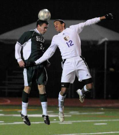 High school fall sports -- boys' soccer -- Ballston Spa's Corey Stewart, right, and Shenendehowa's Tim Johnson battle for the ball during their Section II Class AA boys' soccer semifinal on Tuesday at Schuylerville High School. Ballston Spa won 1-0 and will take on Saratoga Springs in Wednesday's 6 p.m. final at Colonie High. ( Michael P. Farrell/Times Union ) Photo: Michael P. Farrell