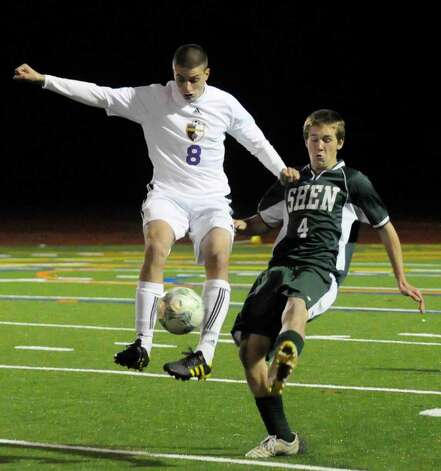 High school fall sports -- boys' soccer -- Ballston Spa's Lucas Audi, left, and Shenendehowa's Mike Jenkins battle for the ball  during Ballston Spa's 1-0 victory in Tuesday's Section II Class AA boys' soccer semifinal at Schuylerville High School. The Scotties will take on Saratoga Springs, a 1-0 winner over Niskayuna, in Wednesday's final at Colonie High School. ( Michael P. Farrell/Times Union ) Photo: Michael P. Farrell