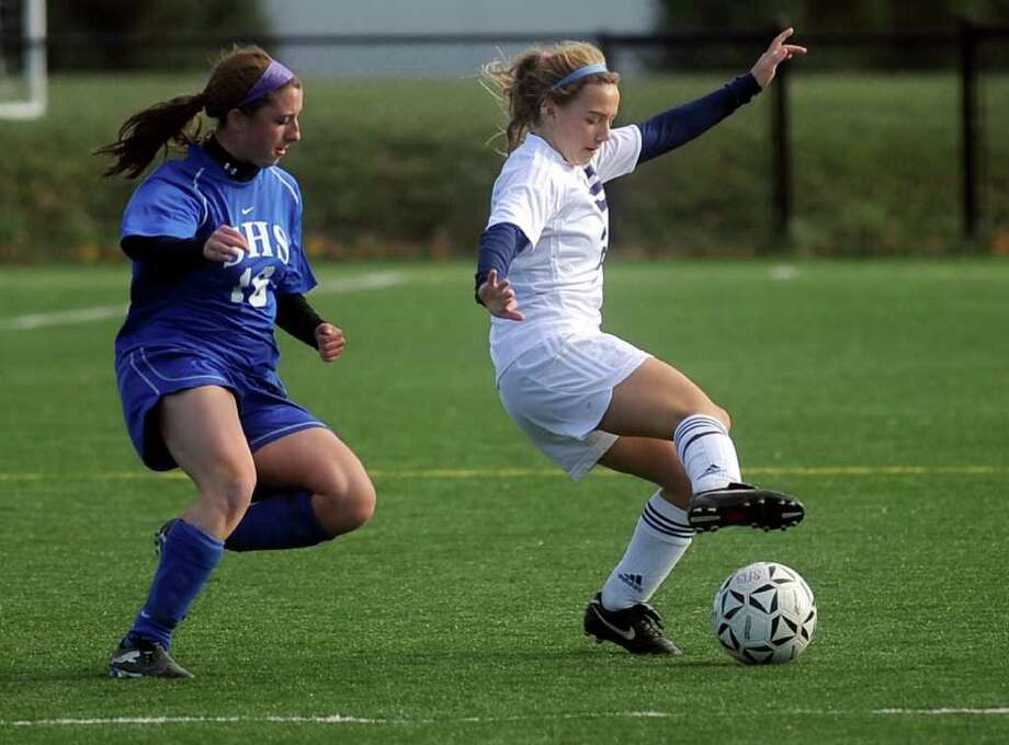 Staples' Alexandra Crofts dribbles the ball as she is defended by Southington's Sam Bottaro during Tuesday's Class LL playoff game at Wakeman Field at Bedford Middle School on November 9, 2010. Photo: Lindsay Niegelberg / Connecticut Post