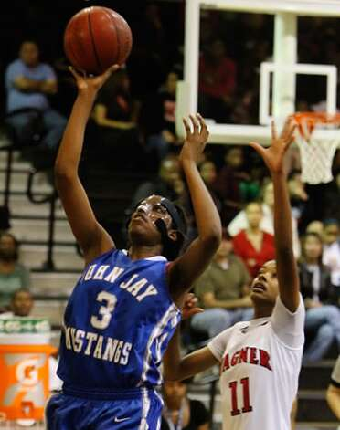 Jay's Aleeya Harris shoots as Wagner's Eboni Watkins defends in the season-opener Tuesday night at Wagner.