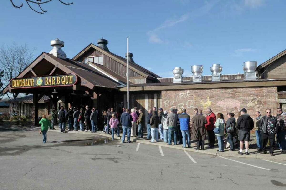 Customers line up outside before the doors open up at the grand opening for the Dinosaur Bar-B-Q in Troy, on Wednesday, Nov. 10, 2010. (Paul Buckowski / Times Union)