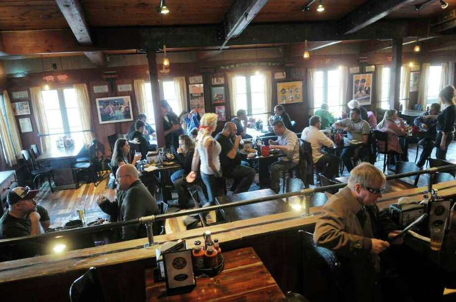 Customers fill the seats  at the grand opening for the Dinosaur Bar-B-Q in Troy, on Wednesday, Nov. 10, 2010.   (Paul Buckowski / Times Union) Photo: Paul Buckowski