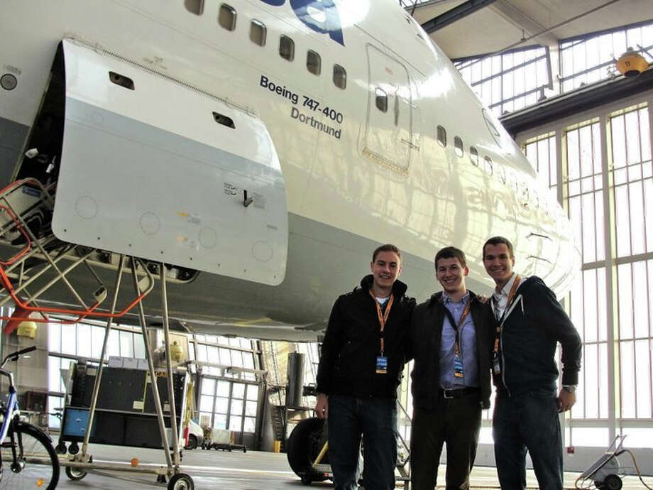 Nick Bartolotta, left, and fellow Embry-Riddle students Jonathan Heckman and Adam Kuebler stand in front of a Lufthansa Boeing 747-400, which later that day flew to Sao Paulo, Brazil. Photo: Contributed Photo / Westport News contributed
