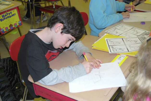 Tim Catalano works on a drawing during Phil Lohmeyer's after-school cartooning class. Photo: Julie Ruth / Greenwich Citizen