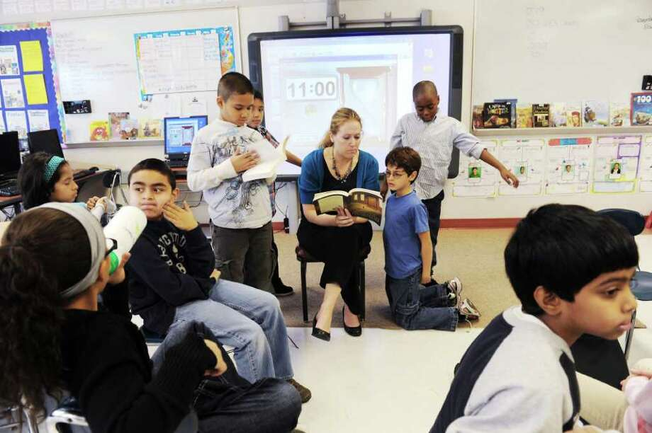 Laura Lynam reads to her fourth grade class at Stark Elementary School in Stamford, Conn. on Wednesday November 10, 2010 Photo: Kathleen O'Rourke / Stamford Advocate
