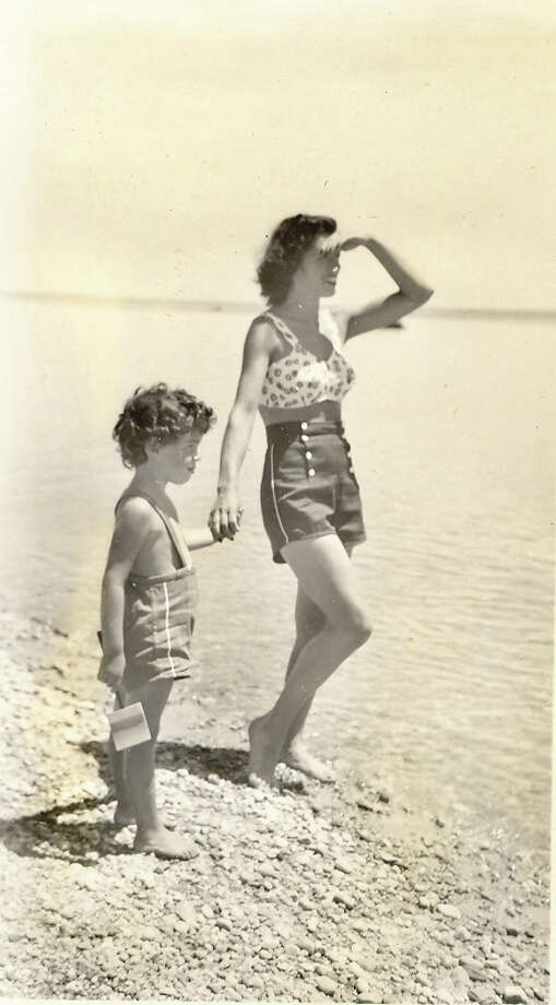 Here, in June of 1945, Toni Cunningham looks out on the water of Westport while holding the hand of her daughter, Sheila, who was 3 years old at the time. Cunninghman, 94, says it's important to note that the jetti is missing in this photograph, because it wasn't constructed until the 1950s. Photo: Contributed Photo / Westport News contributed