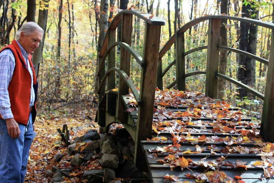 "Chris Filmer shows ""the wishing bridge"" that students who come to Selleck's Woods make a wish on. Photo: Ben Holbrook Contributed Photo, Contributed Photo / Darien News"