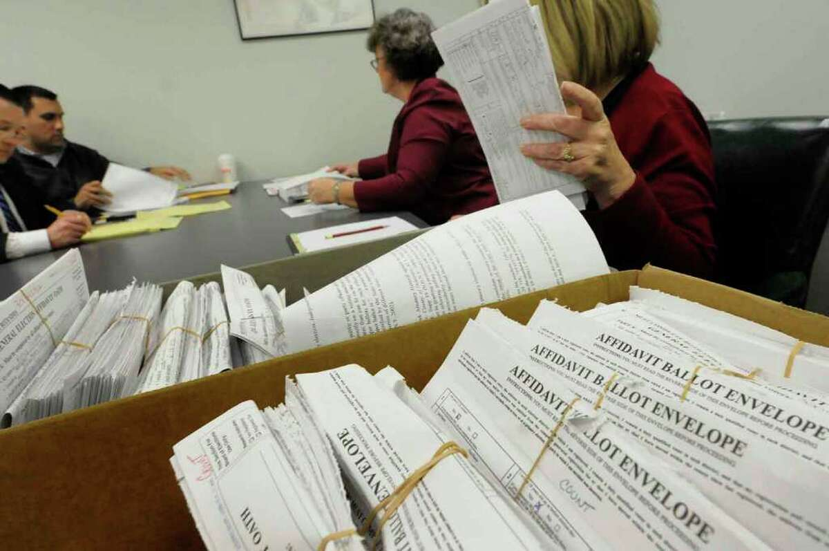 Absentee ballots are counted at the Albany County Board of Elections in the race between Bob Reilly and Jennifer Whelan for 109th New York State Assembly District seat in Albany on Wednesday, Nov. 11, 2010. ( Michael P. Farrell/Times Union )