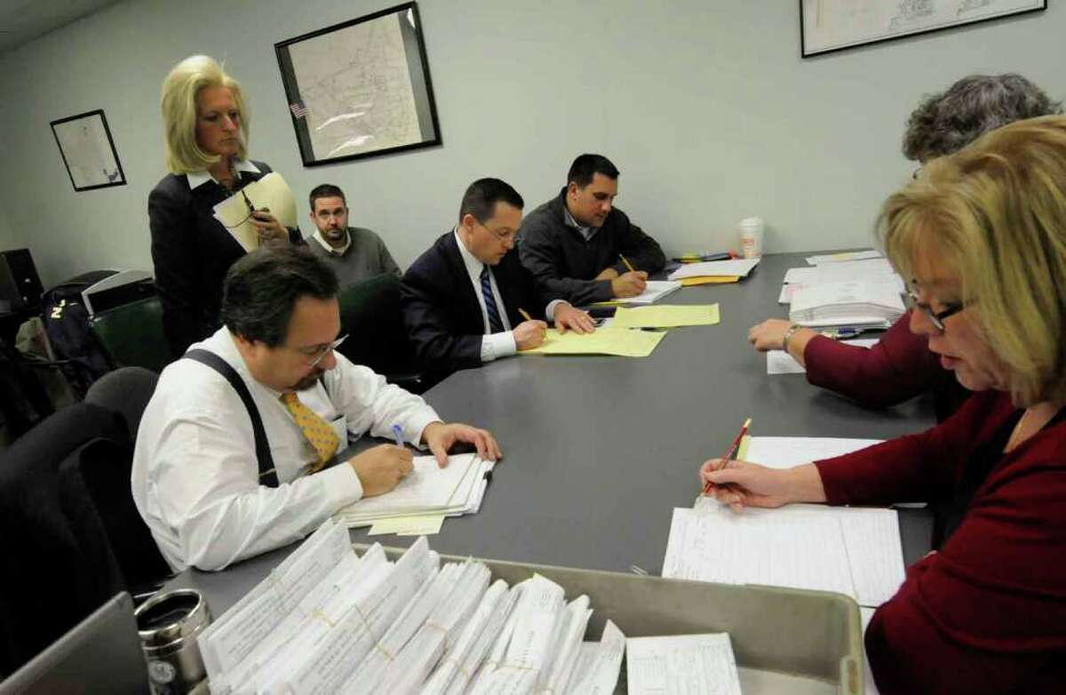 Absentee ballots are counted at the Albany County Board of Elections in the race between Bob Reilly and Jennifer Whelan for 109th New York State Assembly District seat in Albany 11/10/2010. ( Michael P. Farrell/Times Union )