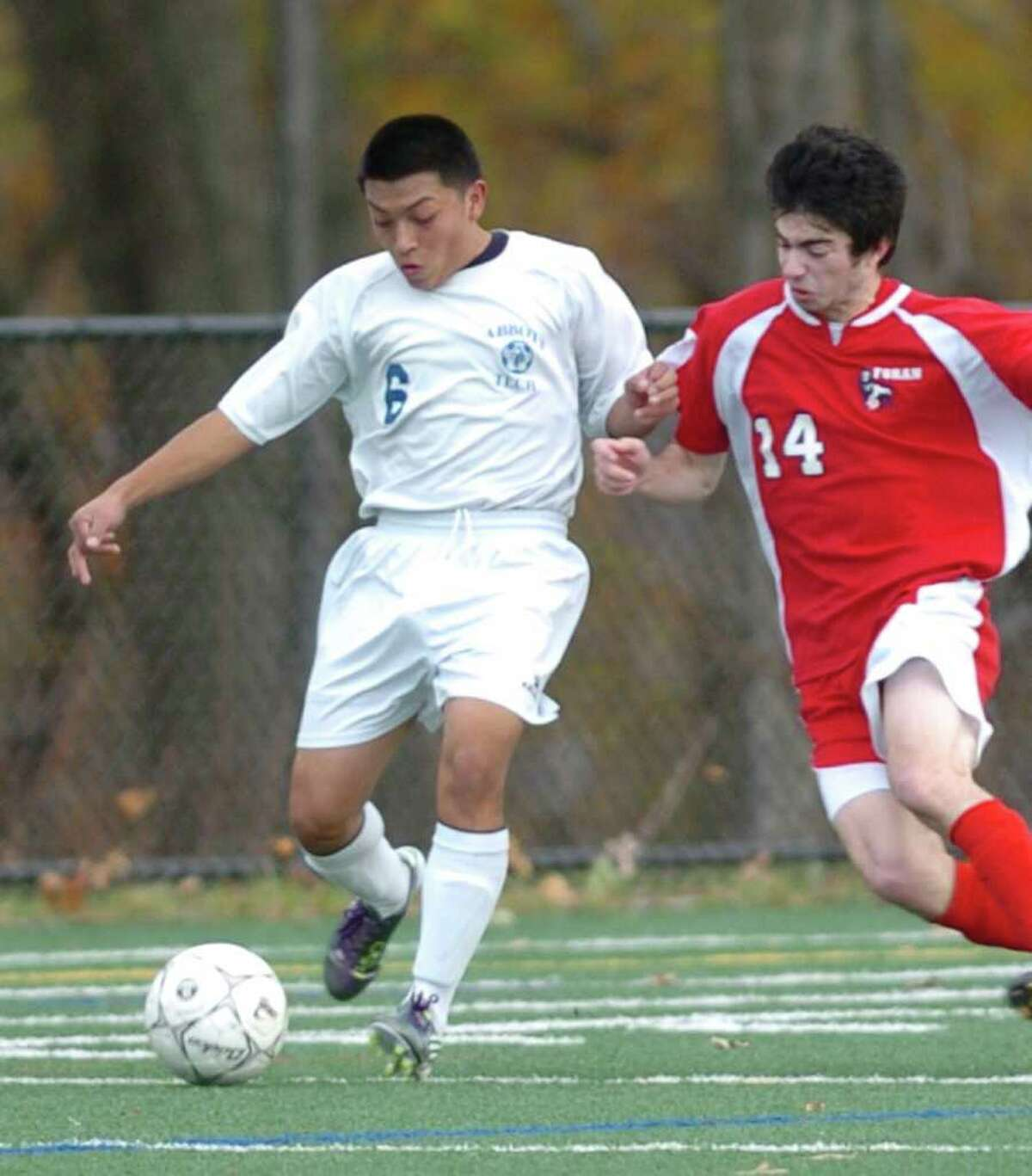 Foran's 14, Robert Millspaugh competes with Abbott Tech's 6, Marco Pauta during the soccer game at Broadview Middle Schoot Nov. 10, 2010.