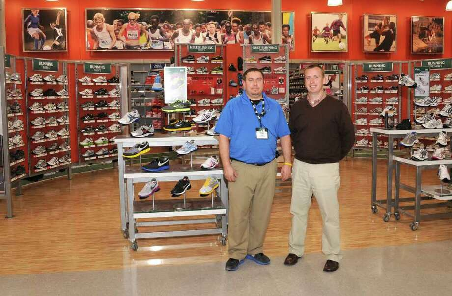 Dick's Sporting Goods store manager Tom Ziebart, left, and community marketing manager Dan LaBreck, at their new location in the Danbury Fair mall, on Wednesday, Nov. 10, 2010. Photo: Jay Weir / The News-Times Freelance