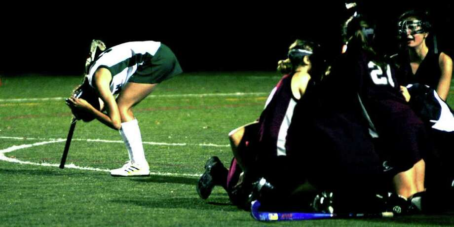 SPECTRUM/Rachel Gioia is in disbelief  for New Milford High School field hockey after the South-West Conference championship match vs. Pomperaug, Nov. 5, 2010 at Weston High School. Photo: Norm Cummings / The News-Times
