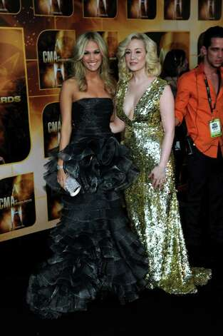 NASHVILLE, TN - NOVEMBER 10:  Singers Carrie Underwood and Kellie Pickler attend the 44th Annual CMA Awards at the Bridgestone Arena on November 10, 2010 in Nashville, Tennessee.  (Photo by Larry Busacca/Getty Images) *** Local Caption *** Carrie Underwood;Kellie Pickler Photo: Larry Busacca, Getty Images / 2010 Getty Images