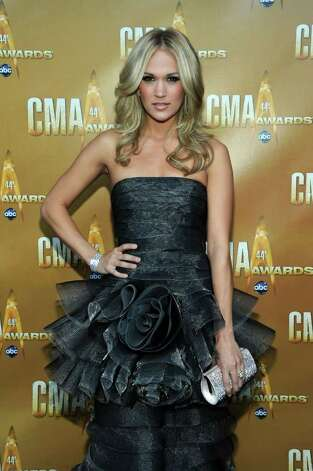 NASHVILLE, TN - NOVEMBER 10:  Co-host, singer Carrie Underwood attends the 44th Annual CMA Awards at the Bridgestone Arena on November 10, 2010 in Nashville, Tennessee.  (Photo by Larry Busacca/Getty Images) *** Local Caption *** Carrie Underwood Photo: Larry Busacca, Getty Images / 2010 Getty Images