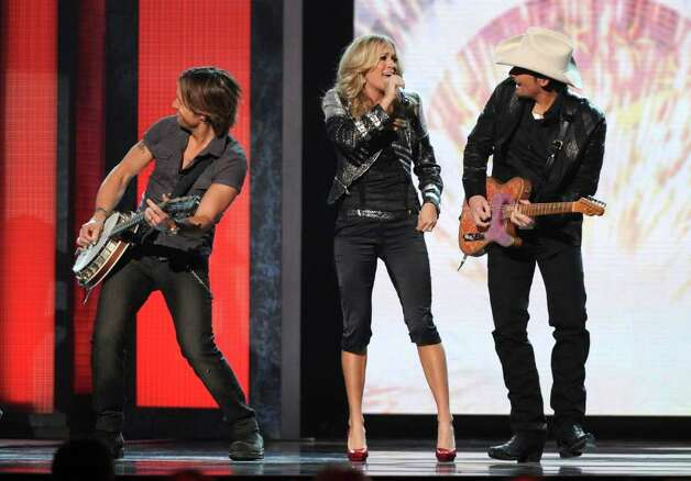 NASHVILLE, TN - NOVEMBER 10:  Keith Urban, Brad Paisley and Carrie Underwood perform onstage at the 44th Annual CMA Awards at the Bridgestone Arena on November 10, 2010 in Nashville, Tennessee.  (Photo by Rick Diamond/Getty Images) *** Local Caption *** Brad Paisley;Carrie Underwood;Keith Urban Photo: Rick Diamond, Getty Images / 2010 Getty Images
