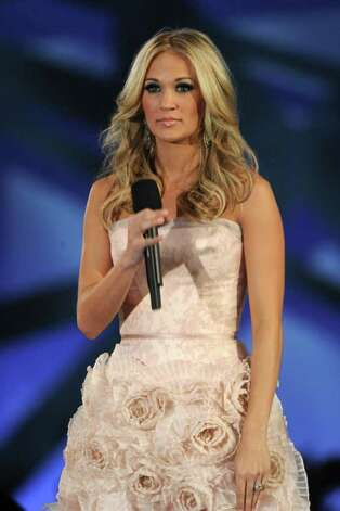 NASHVILLE, TN - NOVEMBER 10: Host Carrie Underwood  speaks at the 44th Annual CMA Awards at the Bridgestone Arena on November 10, 2010 in Nashville, Tennessee.  (Photo by Rick Diamond/Getty Images) *** Local Caption *** Carrie Underwood Photo: Rick Diamond, Getty Images / 2010 Getty Images