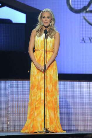 NASHVILLE, TN - NOVEMBER 10:  Co host Carrie Underwood speaks at the 44th Annual CMA Awards at the Bridgestone Arena on November 10, 2010 in Nashville, Tennessee.  (Photo by Rick Diamond/Getty Images) *** Local Caption *** Carrie Underwood Photo: Rick Diamond, Getty Images / 2010 Getty Images