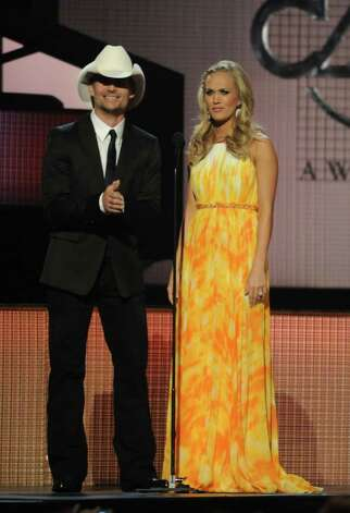 NASHVILLE, TN - NOVEMBER 10:  Hosts Brad Paisley and Carrie Underwood perform onstage at the 44th Annual CMA Awards at the Bridgestone Arena on November 10, 2010 in Nashville, Tennessee.  (Photo by Rick Diamond/Getty Images) *** Local Caption *** Brad Paisley;Carrie Underwood Photo: Rick Diamond, Getty Images / 2010 Getty Images